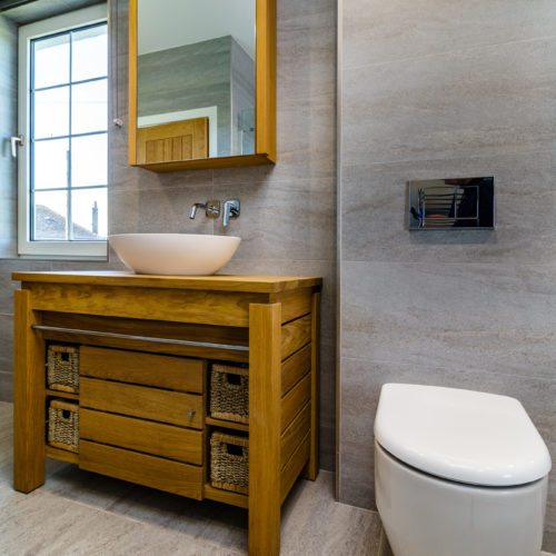 Family bathroom in Plymouth with accent wall tile